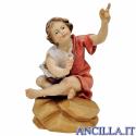 Bambino seduto al falò Ulrich serie 23 cm