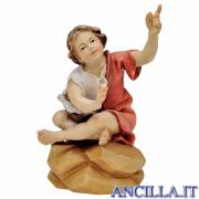 Bambino seduto al falò Ulrich serie 8 cm