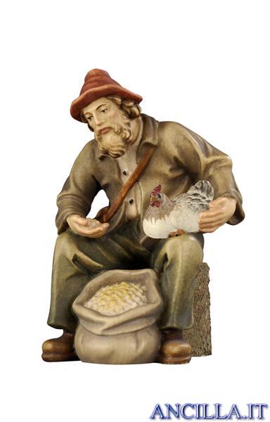Pastore seduto con mangime e gallina Rainell serie 22 cm