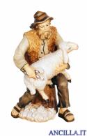 Pastore tosa una pecora Kostner serie 25 cm